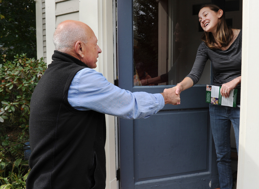 Michael Brennan, Portland's first popularly elected mayor in 88 years, introduces himself to Kent Street resident Nicole Clement as he campaigns for another four years in office.