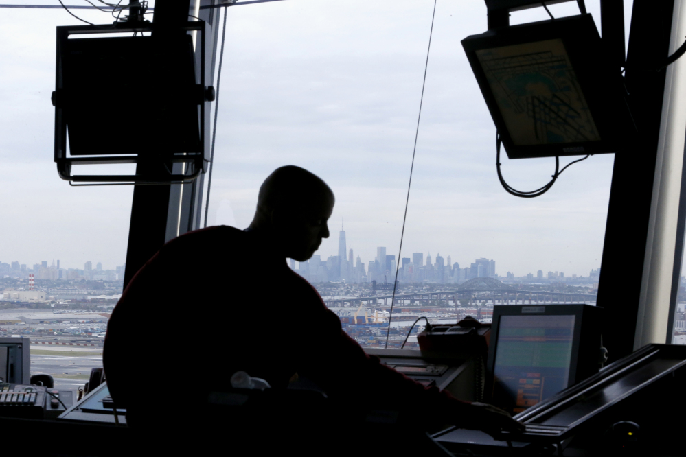 An air traffic controller works in the tower at Newark Liberty International Airport in Newark, N.J.