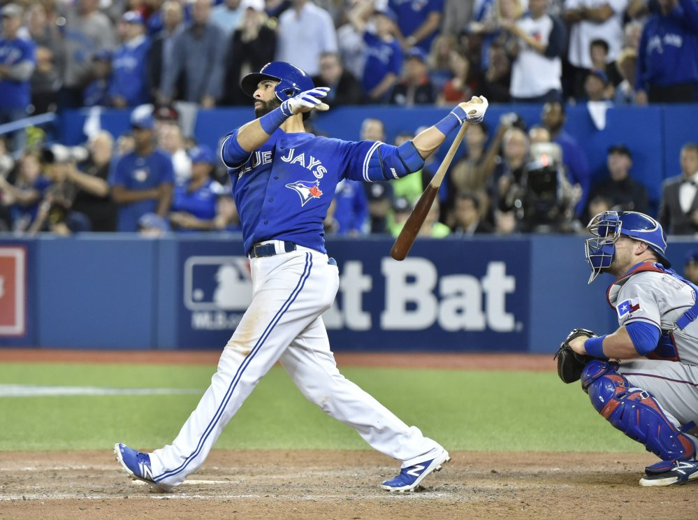 The Blue Jays' Jose Bautista connects for a three-run home run in the seventh inning Wednesday. The shot helped Toronto to a series-clinching 6-3 win.