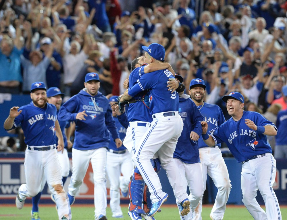 The Toronto Blue Jays celebrate their 6-3 win over Texas in Game 5 of the American League Division Series. The Blue Jays clinched their first trip to the American League Championship Series since 1993.
