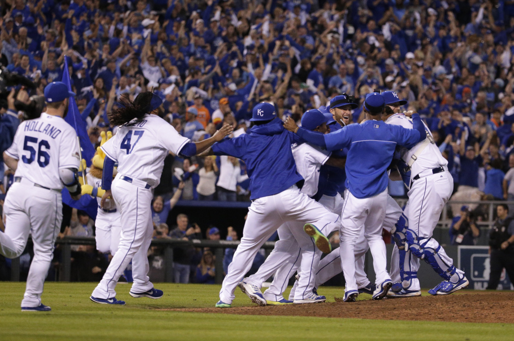 The Royals celebrate their 7-2 win over the Houston Astros in Game 5 their American League Division Series.