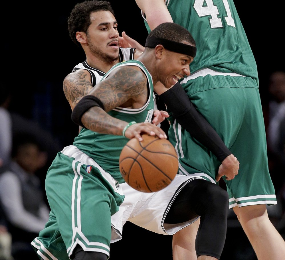 Isaiah Thomas of the Boston Celtics looks to drive against Shane Larkin of the Brooklyn Nets during the second period of Boston's 109-105 victory in a preseason game Wednesday night. The Celtics will be at the Knicks on Friday night.
