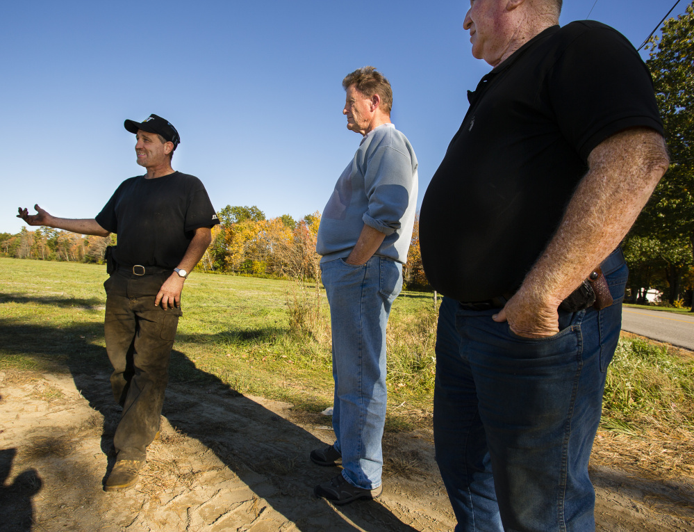 Rick Dubois, owner of Dubois Livestock & Excavating, talks about the company's compost-spreading operation. Sol Fedder, center, a company director, said the compost has been cured to reduce the odor. At right is Rick Dubois' father, Marcel Dubois.