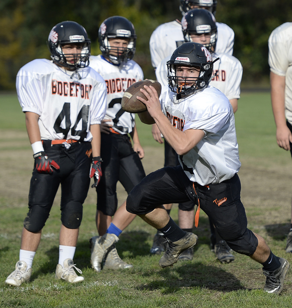 """Joey Curit of Biddeford handles the ball during a fake field goal drill. """"When you're not solid (on special teams), you make mistakes that can come back to haunt you,"""" says Westbrook Coach Jeff Guerrette."""