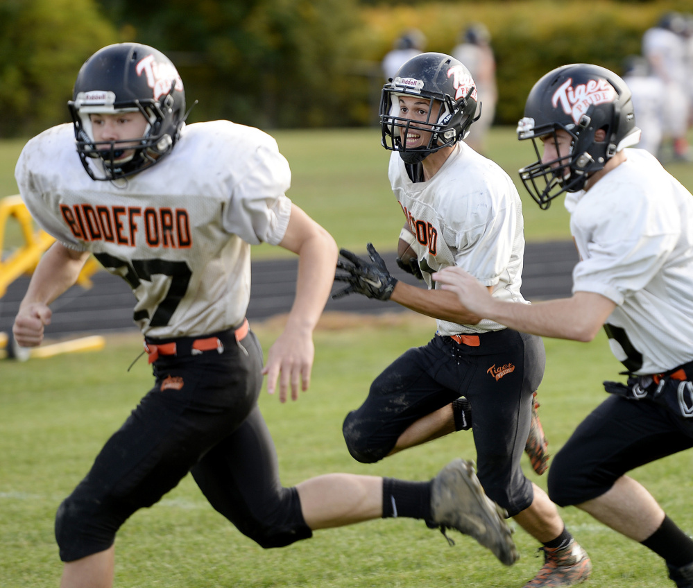 Kickoff and punt returns make the headlines on special teams, but players practice every facet of the game. For example, Tyler Janelle of Biddeford, center, follows his blockers during a fake punt drill.