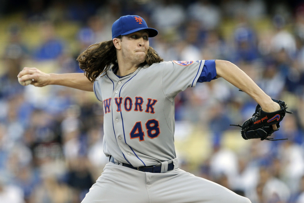 Mets starting pitcher Jacob deGrom works against the Dodgers in the first inning. DeGrom got his second win of the series, holding the Dodgers to two runs on six hits in six innings.