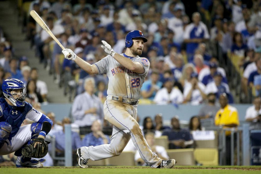 The Mets' Daniel Murphy watches his home run to right field in the sixth inning. The solo home run turned out to be the game-winner as the Mets beat the Dodgers, 3-2, and advanced to the National League Championship Series.