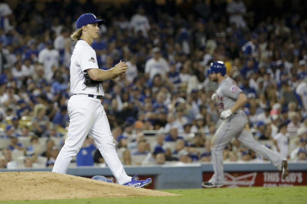 Dodgers starter Zack Greinke looks on after giving up a home run to Daniel Murphy that broke a 2-2 tie in the sixth inning.