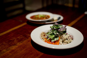 The Schwabish Salad, featuring house-pickled carrots, beets, potato salad, sauerkraut, and dressed greens, is one of the entrée offerings at Stirling & Mull in Freeport, Wednesday, October 14, 2015. Behind the salad is a dish of Hungarian goulash. Gabe Souza/Staff Photographer
