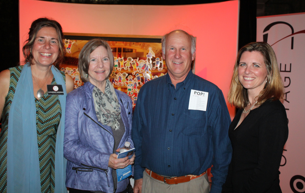 Catherine Anderson, left, director of Ovations Offstage, is joined by board members Lynn Shaffer of Cape Elizabeth, Peter Milliken of North Yarmouth and Alison Vanderhoof of Portland at the POP! benefit at The Portland Company in Portland.