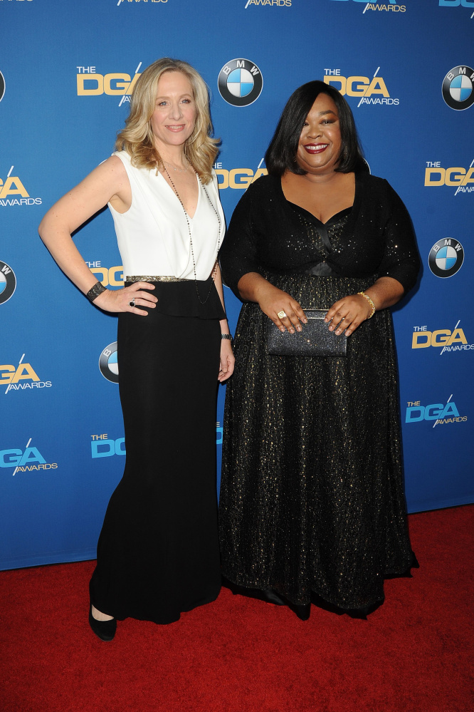"Betsy Beers, left, and Shonda Rhimes at an awards ceremony in 2014. Beers is executive producer for all of Rhimes' series, including the hits ""Grey's Anatomy,"" ""Scandal"" and ""How to Get Away with Murder."""