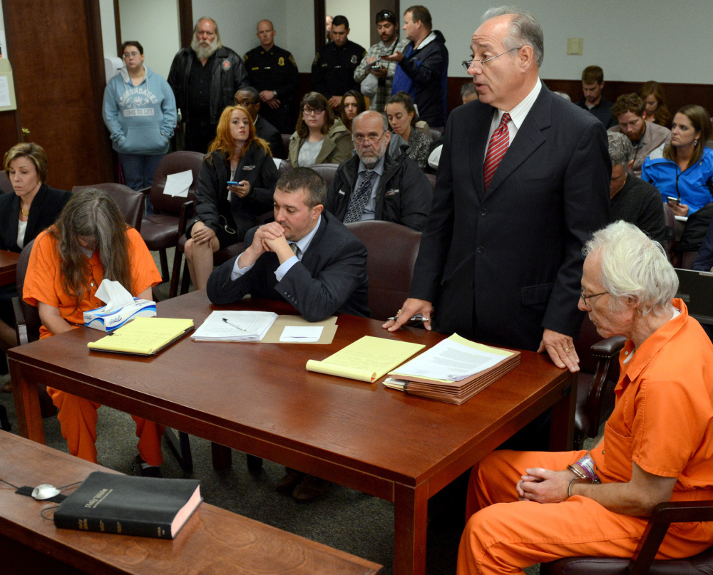 Deborah Leonard, left, and Bruce Leonard, right, sit next to their attorneys during a hearing Friday. The couple didn't intend to seriously injure their sons in a church counseling session, the attorneys said Friday.