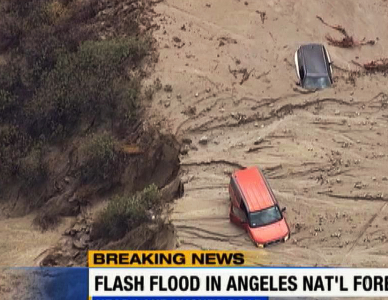 This image made from video provided by KABC-TV shows cars caught in mud in Lake Hughes, Calif., after torrential rains Thursday caused mudslides.