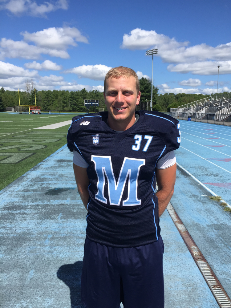 Kicker Sean Decloux shows off the uniform the University of Maine will be wearing Saturday against Yale – a long-ago national power playing in Orono for the first time. Mark Emmert/Staff Writer
