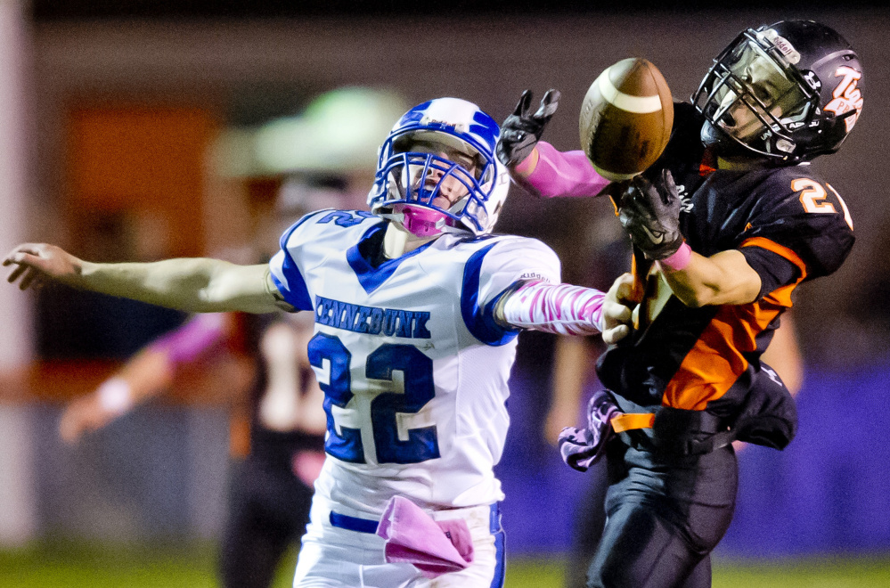 Jesse Lacasse, left, of Kennebunk tries to break up a pass intended for Biddeford's Tyler Janelle, who almost came up with the catch but couldn't hold on in the first half Friday night at Waterhouse Field. Biddeford won, 22-8.