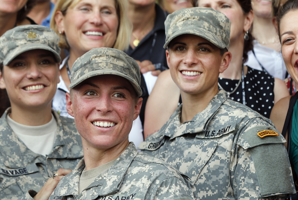 Lt. Shaye Haver, center, and Capt. Kristen Griest, right, are all smiles after completing Ranger School in August.