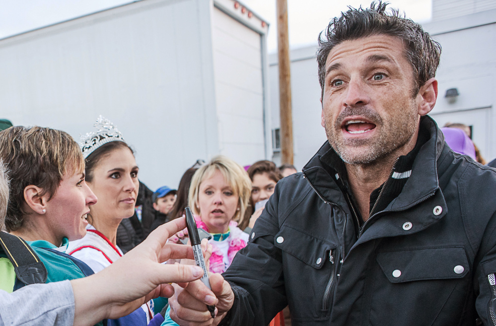 Patrick Dempsey signs autographs before the start of the walking challenges during The Patrick Dempsey Center for Cancer Hope & Healing fundraiser on Saturday in Lewiston. On Sunday, Dempsey will participate in a 50-mile bike ride.