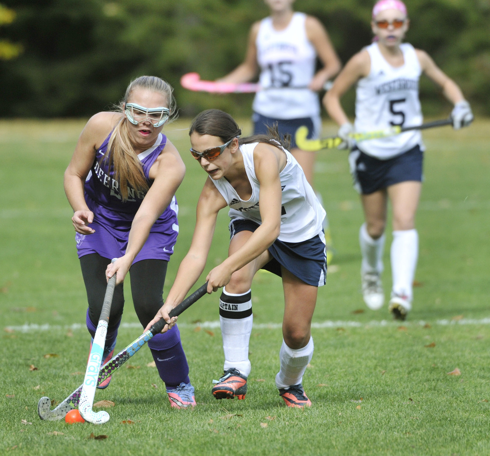Kayla Thoits, left, of Deering, tries to slow down Westbrook's Abby St. Clair. Westbrook, the No. 8 seed in Class A South, will play top-ranked Cheverus in the quarterfinals on Tuesday.