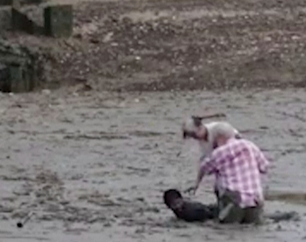 Thai construction worker Chat Ubonchinda lies in the mud to help two Norwegian bird watchers who were sinking.