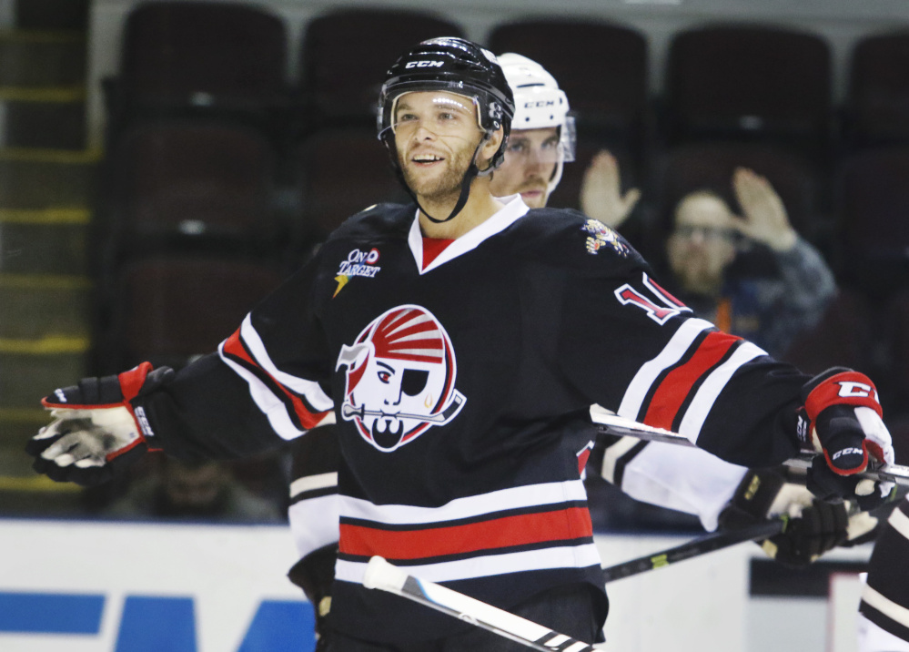 Rob Schremp of the Portland Pirates celebrates after his second goal of the game Sunday in a 5-2 win over the Hershey Bears at Cross Insurance Arena.