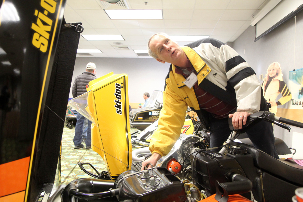 Jim Dunphy of Pittsfield talks about his 1979 Ski-Doo Blizzard at the Maine Snowmobile Show at the Augusta Civic Center on Sunday.