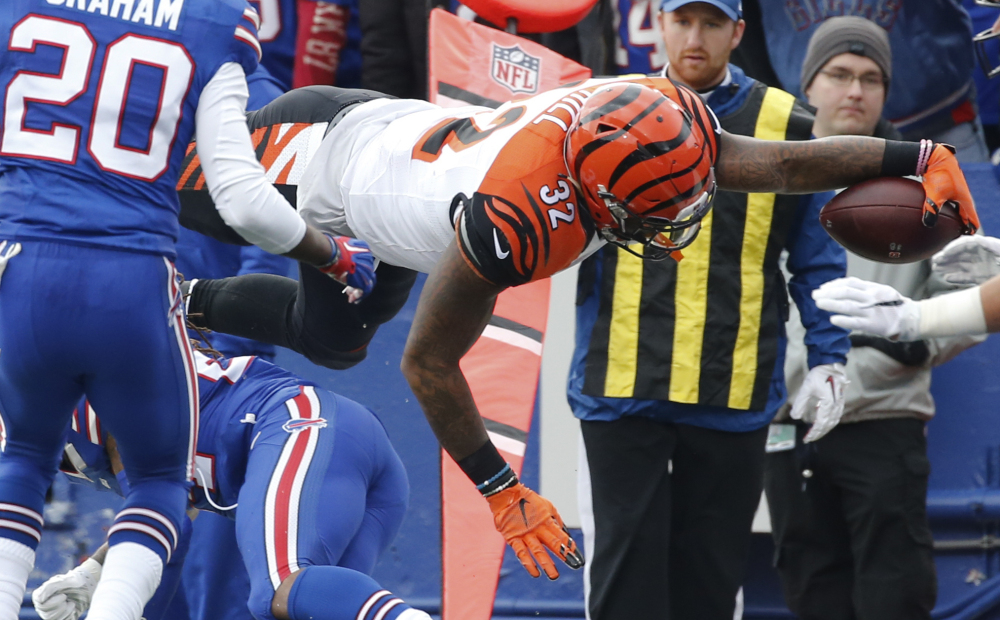 Bengals running back Jeremy Hill dives into the end zone for a touchdown Sunday against the Buffalo Bills. Cincinnati improved to 6-0 with a 34-21 victory.