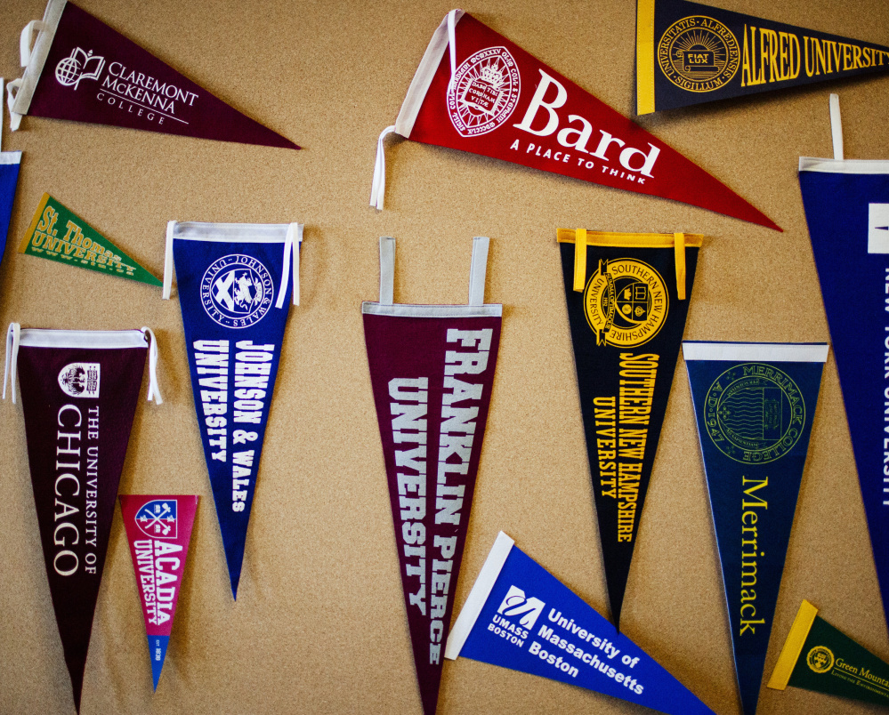 College pennants hang on a bulletin board at the guidance office at Portland High School.