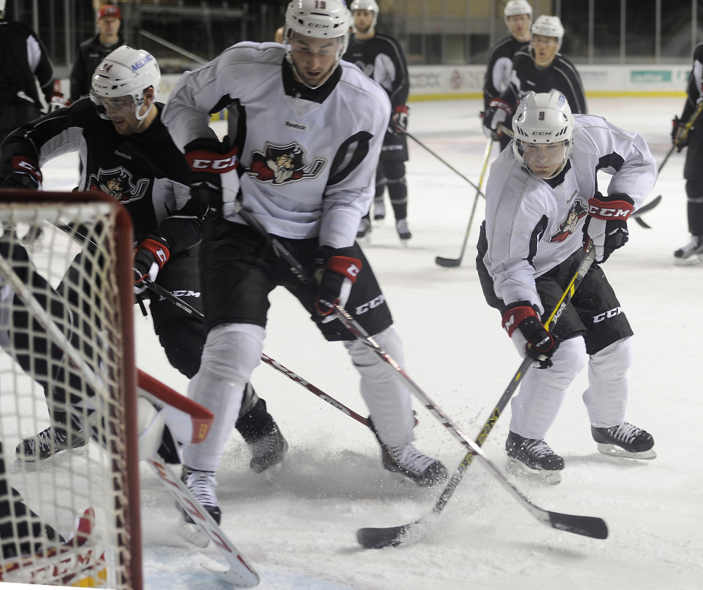 Rocco Grimaldi, right, is the Pirates shortest player at 5-foot-6. The second-year pro feels his lower center of gravity works to his advantage.practice. (Photo by Gordon Chibroski/Staff Photographer)