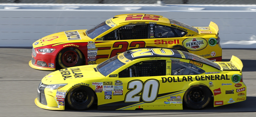 Joey Logano, top, and Matt Kenseth run side-by-side at the Kansas Speedway on Sunday, in a race won by Logano in the closing laps after his car nudged Kenseth's into a spin.