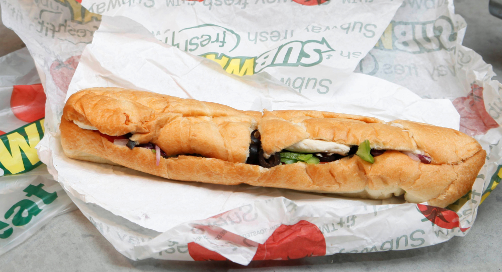 The Subway restaurant chain says it plans to switch to meat from animals raised without antibiotics over the next decade.