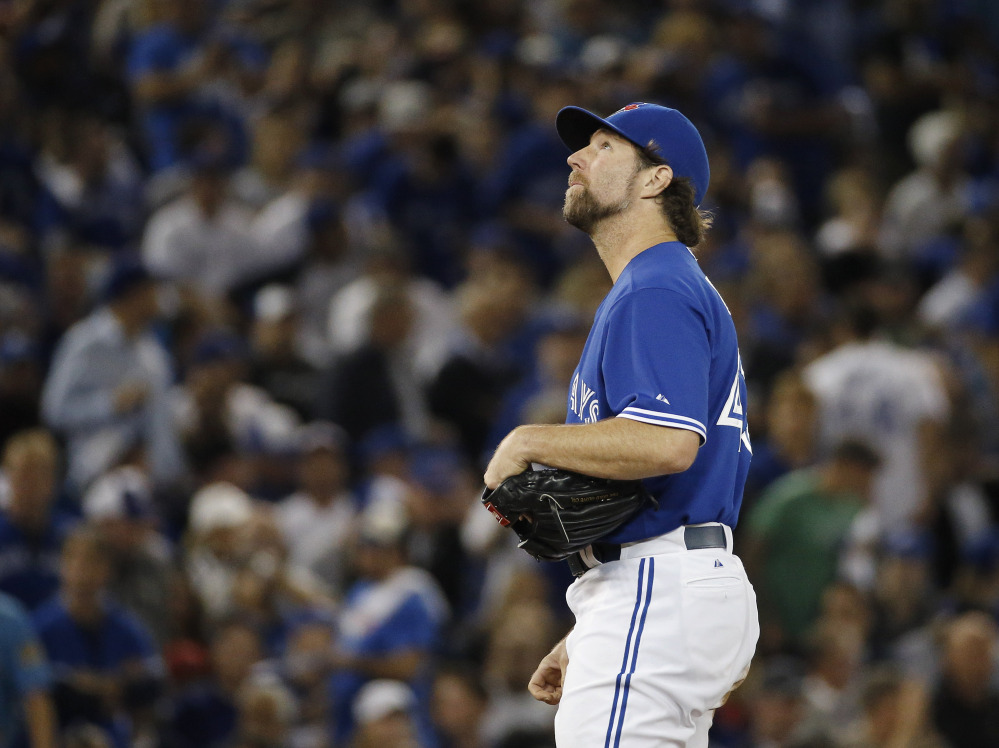 Blue Jays starting pitcher R.A. Dickey appears to be looking for answers after being relieved in the second inning. Dickey gave up five runs and got just five batters out.
