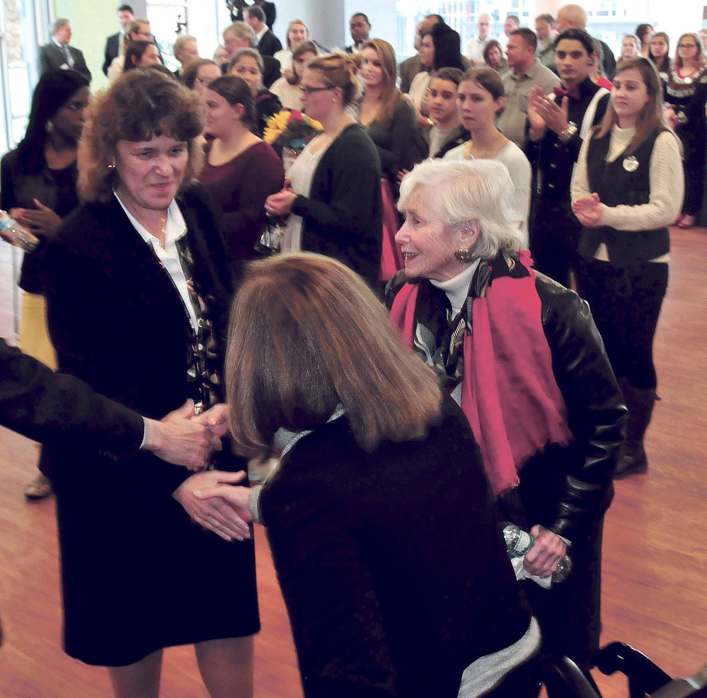 Thomas College President Laurie Lachance, left, shakes hands Tuesday with Margie Lunder Goldy, center, and Paula Lunder at Thomas College during a news conference announcing the Center for Innovation in Education. The Lunder Foundation contributed money toward the center in Waterville.