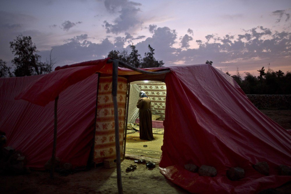 Many Syrian refugees who have fled fighting are living outdoors. The Associated Press