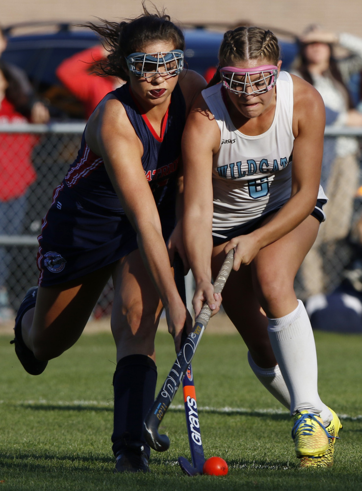 Alicia Dumont of Gray-New Gloucester, left, competes for the field hockey ball with Alie Jones of York during the first half of York's 7-1 victory Tuesday in a Class B South quarterfinal.