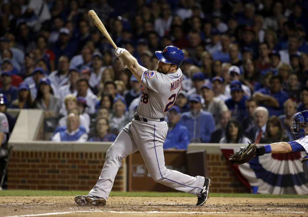 The Mets' Daniel Murphy hits a home run in the third inning Tuesday night in Game 3 of the National League Championship Series. The Mets took a 2-1 lead and Murphy tied a record by hitting a home run in his fifth straight playoff game.