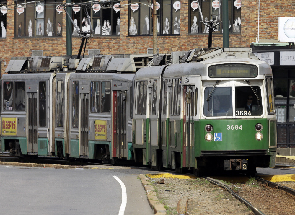 Boston's MBTA is asking riders to weigh in on the exterior appearance of new train cars that it plans to add to its system to replace cars like these.