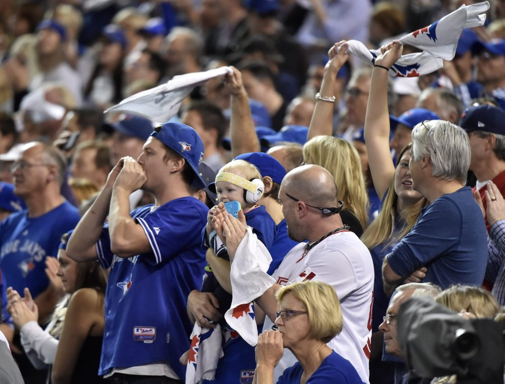 Blue Jays fans cheer, with their team on its way to a 7-1 win and Game 6 of the American League Championship Series on Friday in Kansas City.