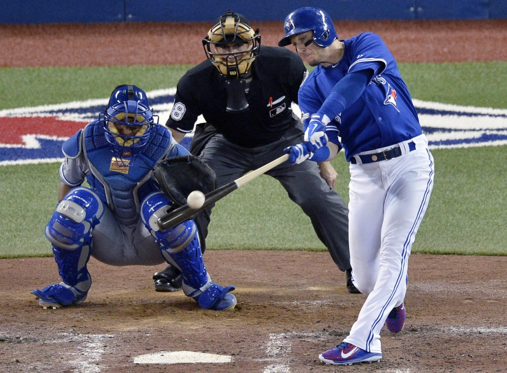 Toronto's Troy Tulowitzki hits a three-run double to break the game open in the sixth inning. The Blue Jays scored four runs in the inning to take a 5-0 lead.