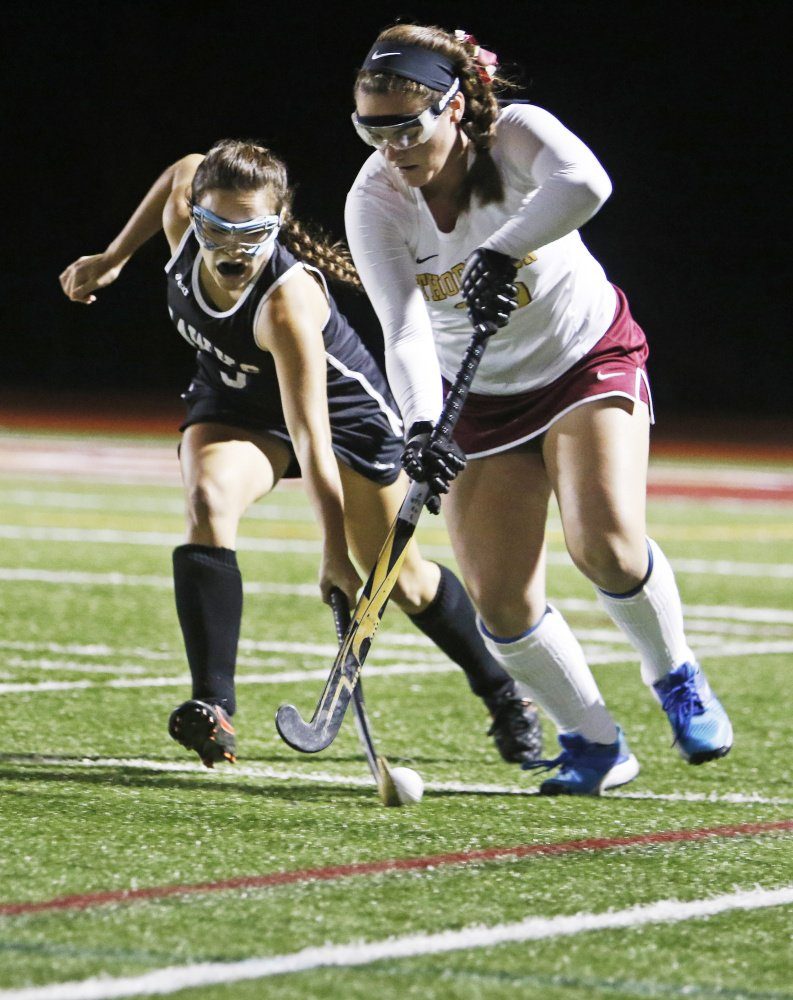 Andrea Longtin of Marshwood attempts to knock the ball away from Emma Dutremble of Thornton Academy in the first half Wednesday night. Thornton scored two second-half goals to win the Class A South field hockey quarterfinal, 2-1.