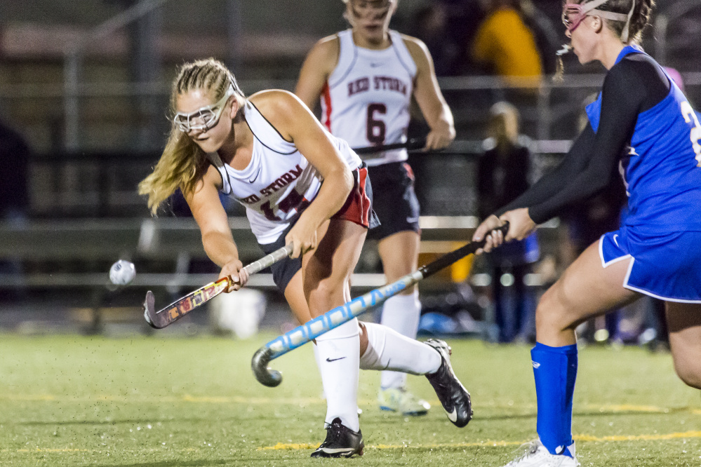 Lucy Bogdanovich of Scarborough knocks the ball away before Sydney Bell of Falmouth can get to it Wednesday night. Scarborough won 1-0 on a last-minute goal and will be home against Thornton Academy in the semifinals Saturday.