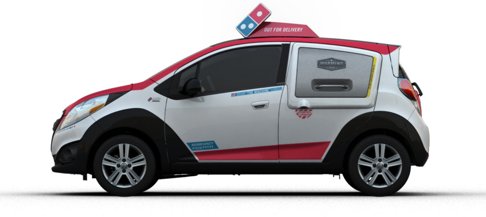 "Domino's new pizza-delivery vehicles feature the company's logo and colors and a ""puddle light"" that projects the Domino's logo on the ground. With all this, the vehicles serve as marketing tools wherever they are driven."