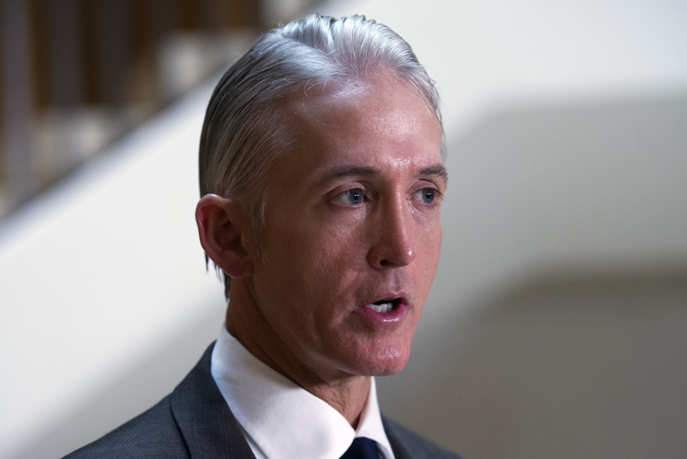 House Select Committee on Benghazi Chairman Trey Gowdy, R-S.C., above, faces scrutiny from Rep. Elijah Cummings, D-Md., below, and Cummings' staff.