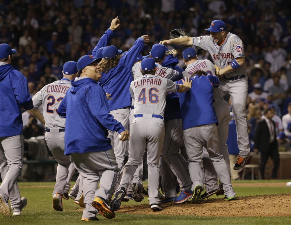 The Mets celebrate their first National League pennant in 15 years with Wednesday night's 8-3 win at Chicago.