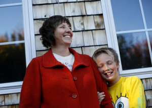 "Florence Reed with her son at their nearly net-zero home in Surry. Friends first ""lured"" Reed and her husband, Bruce Maanum, to the area, and ""we also really appreciated the environmental ethic that was so prevalent here, and all that was going on in regards to sustainable organic farming."""