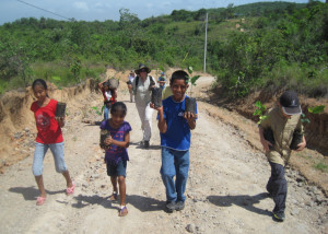 Reed with a crew of children on the way to plant trees in Tranquilla, Panama.