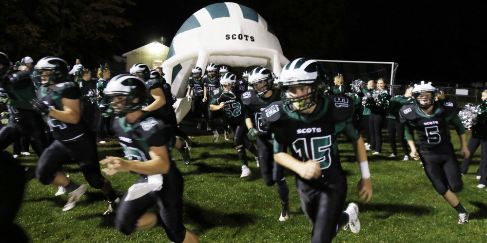 A helmet-shaped tunnel provided by the football boosters club at Bonny Eagle gives young players  a sense of what it's like to be in the big time.