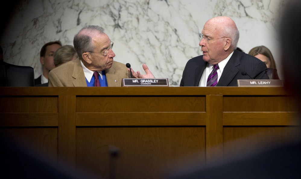 Senate Judiciary Committee Chairman Sen. Charles Grassley, R-Iowa, left, and the committee's ranking member Sen. Patrick Leahy, D-Vt. talk on Capitol Hill in Washington, Monday, Oct. 19, 2015, during the committee's hearing on the Sentencing Reform and Corrections Act of 2015.  (AP Photo/Carolyn Kaster)