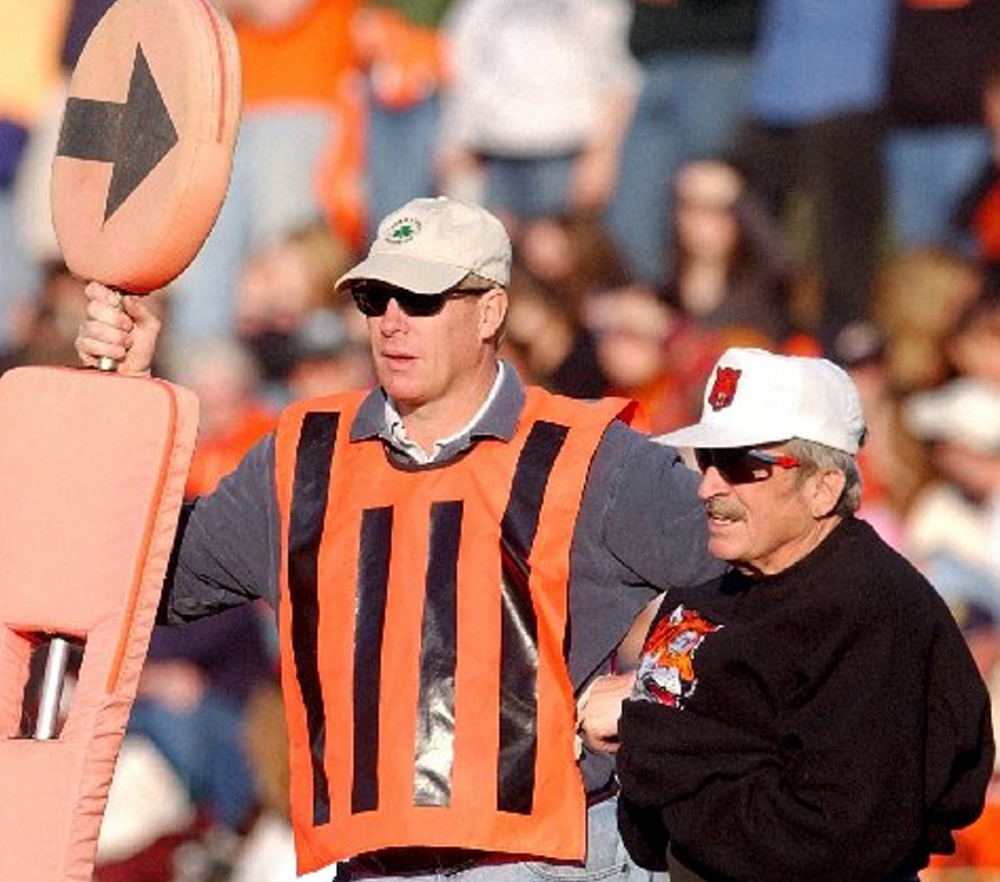 Sonnie Gamache, right, stands on the sideline of a Gardiner Area High School football game in 2005. Gamache has measured first downs for 11 coaches.