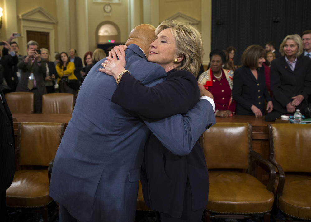 Hillary Clinton hugs Rep. Elijah Cummings, D-Md., after her testimony. Democrats accused Republicans of using the committee to try to damage her candidacy for president.