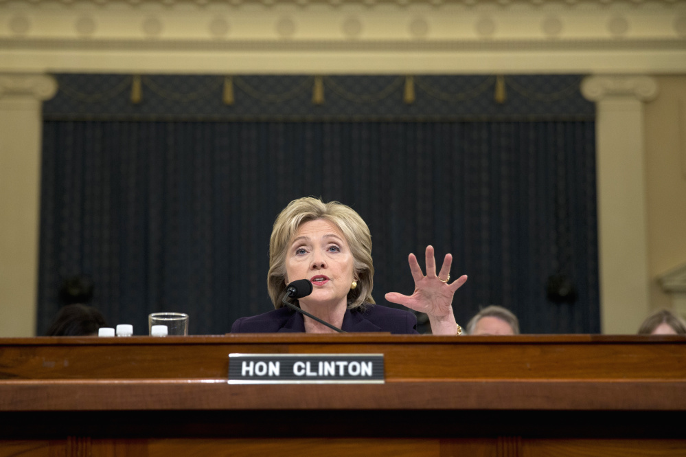 Former Secretary of State Hillary Clinton testifies Thursday during a House committee hearing on the attacks that killed four Americans at the Benghazi embassy in Libya in 2012.